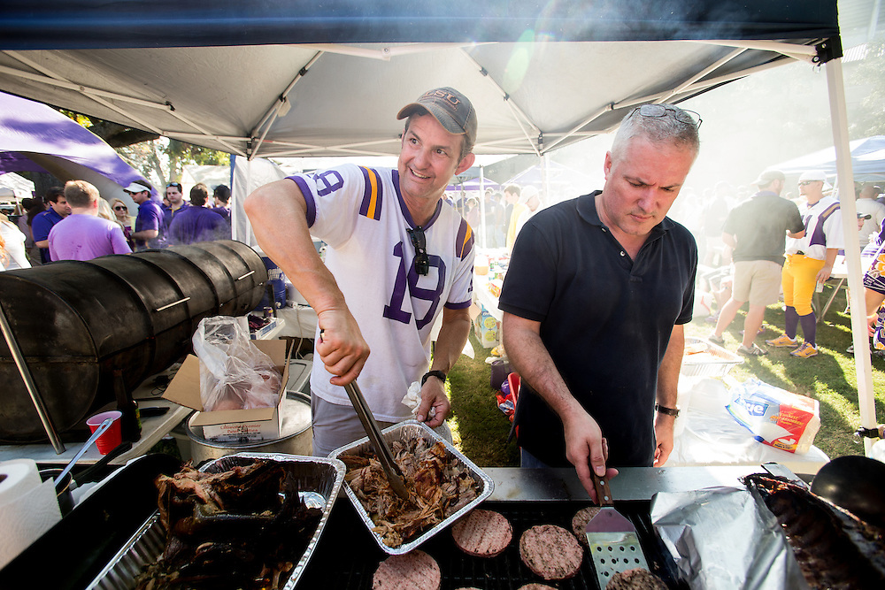 BATON ROUGE, LA - NOVEMBER 3: Clark McLendon (in jersey) cooks at a tailgate prior to the Alabama-LSU game, photographed in Baton Rouge, Alabama on November 2, 2012. Photograph © 2012 Darren Carroll