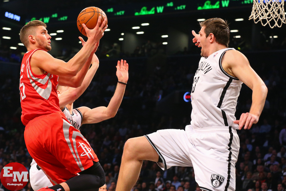 Apr 1, 2014; Brooklyn, NY, USA; Houston Rockets forward Chandler Parsons (25) shoots the ball while being defended by Brooklyn Nets forward Mirza Teletovic (33) during the second quarter at Barclays Center.