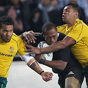 Sitiveni Sivivatu, New Zealand, is tackled by Digby Ioane, (left) and Kurtley Beale, (right) during the New Zealand V Australia Tri-Nations, Bledisloe Cup match at Eden Park, Auckland. New Zealand. 6th August 2011. Photo Tim Clayton