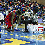 Delaware 87ers Trainer Christina Kennedy call for help as Delaware 87ers Guard Nolan Smith (10) lays under the basket in pain as Grand Rapids Drive Center Hasheem Thabeet (34) prays in the first half of a NBA D-league regular season basketball game between the Delaware 87ers and the Grand Rapids Drive (Detroit Pistons) Friday, Jan. 09, 2015 at The Bob Carpenter Sports Convocation Center in Newark, DEL