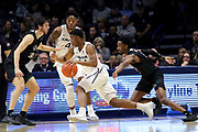 Xavier guard KyKy Tandy (24) dribbles towards the lane against Green Bay defenders during an NCAA college basketball game, Wednesday, Dec. 4, 2019, in Cincinnati. Xavier defeated Green Bay 84-71 (Jason Whitman/Image of Sport)