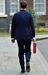 © Licensed to London News Pictures. 16/03/2016. Westminster, UK. Chancellor of the Exchequer George Osborne poses for photographers outside 11 Downing Street before presenting his budget to Parliament on March 13, 2015. London, UK. Photo credit: Ray Tang/LNP