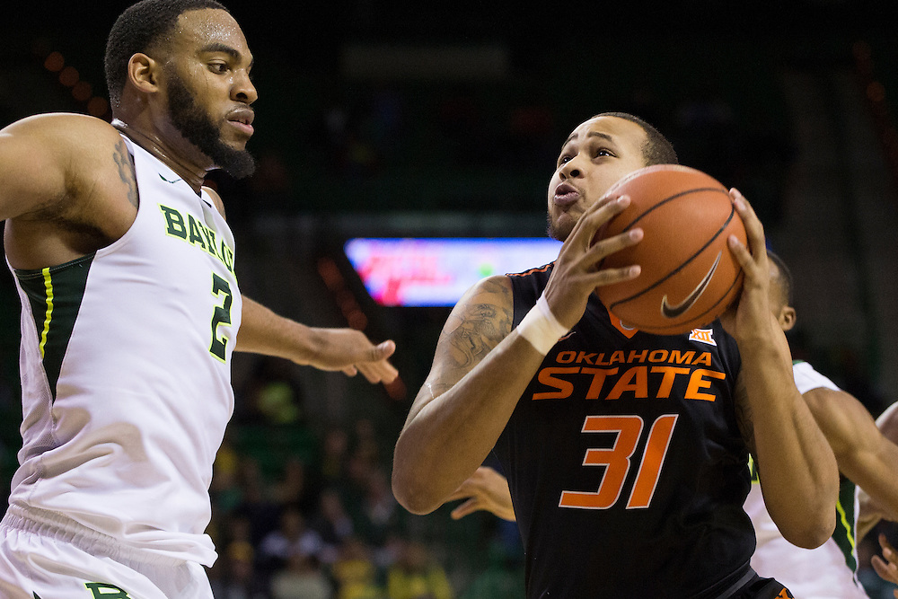 WACO, TX - JANUARY 5: Chris Olivier #31 of the Oklahoma State Cowboys drives to the basket against the Baylor Bears on January 5, 2016 at the Ferrell Center in Waco, Texas.  (Photo by Cooper Neill/Getty Images) *** Local Caption *** Chris Olivier