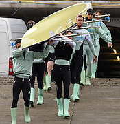 Putney. London,  Great Britain.<br /> Cambridge carry their boat to the shore to prepare for their training outing.<br /> 2016 Tideway Week, Putney. Putney Embankment, Championship Course. Tiver Thames.<br /> <br /> Thursday  24/03/2016 <br /> <br /> [Mandatory Credit; Peter Spurrier/Intersport-images]<br /> <br /> CUBC. Bow: Felix Newman, 2: Ali Abbas, 3: Charles Fisher, 4: Clemens Auersperg, 5: Luke Juckett, 6: Henry Hoffstot, 7: Ben Ruble, Stroke: Lance Tredell, Cox: Ian Middleton