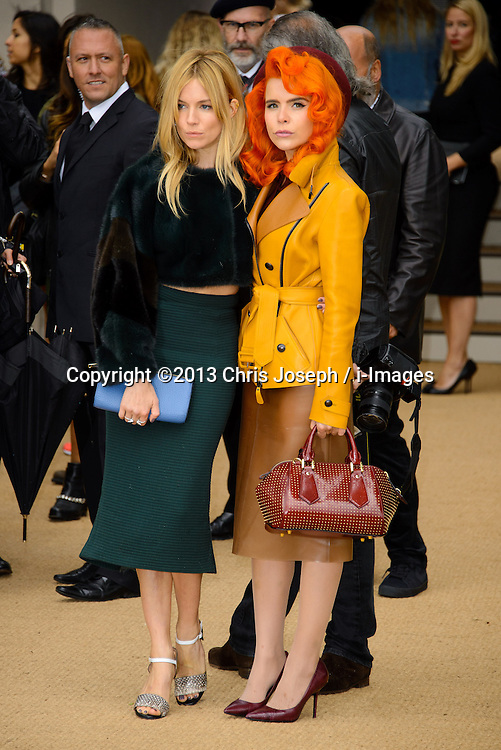 Arrivals for Burberry Prorsum Spring / Summer 2014. <br /> Sienna Miller and Paloma Faith arrives for the Burberry Prorsum Spring / Summer 2014 show, London, United Kingdom. Monday, 16th September 2013. Picture by Chris Joseph / i-Images