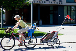 Young mother with child on a bicycle at prologue (17,8km) of Tour de Slovenie 2012, on June 17 2012, in Ljubljana, Slovenia. (Photo by Matic Klansek Velej / Sportida.com)