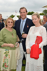 Left to right, NINA CAMPBELL, her son MAX KONIG and his wife JULIA at the Cartier Queen's Cup Polo final at Guard's Polo Club, Smiths Lawn, Windsor Great Park, Egham, Surrey on 14th June 2015