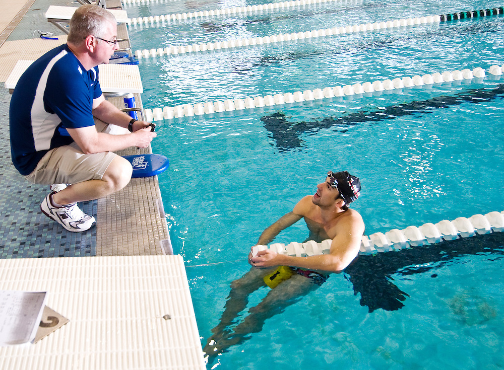 Freelance photo by Matt Roth.Baltimore, Maryland.Thursday, May 7, 2009.Assignment ID: 20102758A..Michael Phelps talks with his coach, Bob Bowman, during North Baltimore Aquatic Club practice at the Loyola College Aquatic Center in Baltimore, Thursday, May 7, 2009.