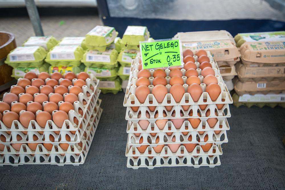 Cartons of brown eggs are stacked on a table in Amsterdam, Netherlands