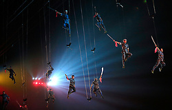 Actors dressed as Communist Red Army soldiers perform hanging from wires  during 'Mao Zedong Comes from China', a show based on the former Communist leader's life in an outdoor theatre in Shaoshan, Hunan Province in central China, 27 April 2016. The show depicts Mao's life experience during the upheavals of the revolution and civil war leading to the founding of the People's Republic of China.