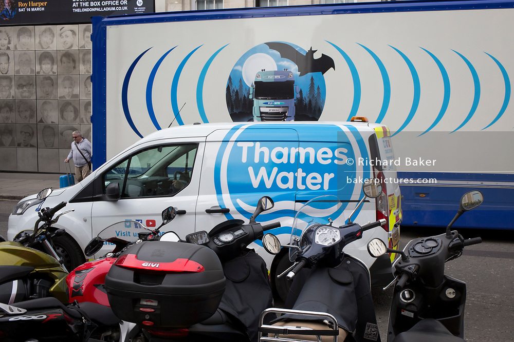 The design on the side of an HGV for the rehearsal studio company 'Fly By Nite' and a Thames Water van in Great Marlborough Street, on 5th March 2019, in London, England.
