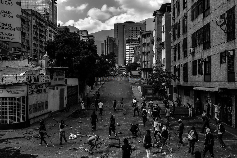 Caracas, Venezuela - 6/4/17: Thousands of people take the streets in the eastern neighborhoods of Caracas city to protest against the decision of the Supreme Court of Justice that orders the National Assembly to cease its powers of contempt and these be assumed directly by the highest court . The National Assembly was won in elections held on October 15, 2015 by the coalition of opposition parties MUD obtaining the qualified majority of the Venezuelan parliament. Different representatives of the international community raised their voices in protest of what they consider an attack on democracy and breakdown of the rule of law in Venezuela. (Photography: Gregorio Marrero)