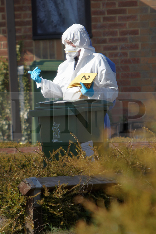 © Licensed to London News Pictures.  28/03/2012. AYLESBURY, UK. Police and forensic officers investigate a shooting in the Walton Court area of Aylesbury, Buckinghamshire. Gunshots were reported at 10am this morning and a man found in a bungalow. He was taken to hospital with life threatening injuries. Unconfirmed reports suggest that the man was in a wheelchair and recovering from an earlier shooting incident. Photo credit :  Cliff Hide/LNP