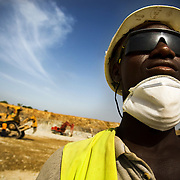 Mine worker Mahmoud Nanga watches over excavation operations in the main pit of the Youga gold mine near the town of Youga, approximately 205 km southeast of Burkina Faso's capital Ouagadougou on Tuesday April 28, 2009.
