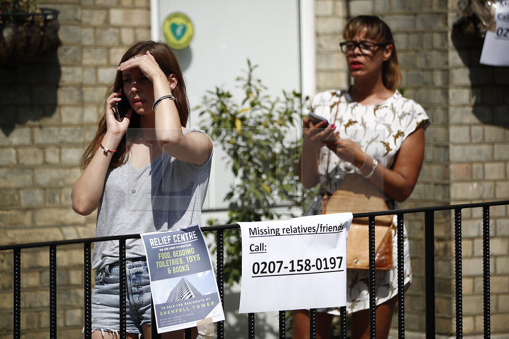 © Licensed to London News Pictures. 14/06/2017. London, UK. People try to reach their loved ones as firefighters try to control the Grenfell Tower fire in west London on 14 June 2017. Photo credit: Tolga Akmen/LNP