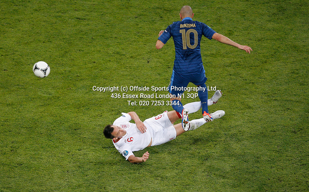11/06/2012 European football championships. France v England.<br /> John Terry flies into a tackle on Benzema.<br /> Photo: Mark Leech.