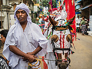 24 OCTOBER 2015 - YANGON, MYANMAR: Shia men wait for a procession to start at Punja Mosque on Ashura in Yangon. Ashura commemorates the death of Hussein ibn Ali, the grandson of the Prophet Muhammed, in the 7th century. Hussein ibn Ali is considered by Shia Muslims to be the third imam and the rightful successor of Muhammed. He was killed at the Battle of Karbala in 610 CE on the 10th day of Muharram, the first month of the Islamic calendar. According to Myanmar government statistics, only about 4% of the population is Muslim. Many Muslims have fled Myanmar in recent years because of violence directed against Burmese Muslims by Buddhist nationalists.    PHOTO BY JACK KURTZ