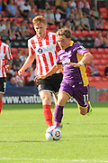 Jack Munns during the Vanarama National League match between Lincoln City and Cheltenham Town at Sincil Bank, Lincoln, United Kingdom on 8 August 2015. Photo by Antony Thompson.
