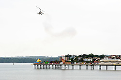 © Licensed to London News Pictures.  02/06/2017; Torbay, Devon, UK. Torbay Airshow 2017. Press call for Launch of the 2017 Torbay Airshow. An Autogyro performs a display over Tor Bay ahead of the 2017 Torbay Airshow. The Autogyro flying display, also known as a Gyrocopter or Gyroplane, is described as a flying windmill or a rotating parachute which looks like a sycamore seed gently floating down as it spins.The 2017 Torbay Airshow is set to return this weekend on Saturday 3 and Sunday 4 June with an action packed programme of world class air displays. The world's premier aerobatic team The Red Arrows will be debuting a new routine in the first display of their season, featuring their trademark combination of close formations and precision flying. The full display programme for the weekend begins on the Saturday between 2-3pm with The Tigers Freefall Parachute Display Team, Team Raven Aerobatic Display Team, the Percival Piston Provost and the Strikemaster. From 3-4pm will be the highly anticipated display by the Red Arrows, former British Female Aerobatic Champion Lauren Richardson in her Pitts Special S1-S and world aerobatic competitor Gerald Cooper in his Xtreme XA41. Finishing off the action packed afternoon from 4-5pm will see displays from the AutoGyro, the Battle of Britain Memorial Flight aircraft, the PBY5A Catalina seaplane, The Blades and the Royal Air Force's Typhoon FGR4. Sunday afternoon will see each of the aircraft take to the skies again before the weekend closes with a final display from the RAF Chinook team. The two day show, which had its inaugural event last year, takes place on Paignton Green with the Bay providing a stunning natural amphitheatre for viewing the air displays and the perfect location for a large coastal airshow event. To stay up to date with the latest Torbay Airshow news and updates follow @torbayairshow on Facebook, Twitter and Instagram or visit www.torbayairshow.com. Picture credit : Simon Chapman/LNP