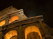 Low angle, night scene of the Colosseum in Rome, Italy.