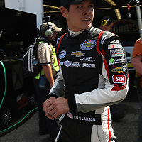 Clorox Chevrolet driver Kyle Larson is seen in the garage area, during a NASCAR Drive4COPD Nationwide Series practice session at Daytona International Speedway on Thursday, February 21, 2013 in Daytona Beach, Florida.  (AP Photo/Alex Menendez)