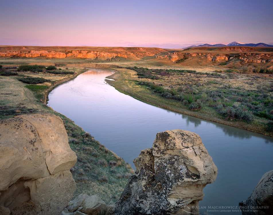 Dusk over the Milk River and sandstone formations of Writing on Stone Provincial Park Alberta Canada