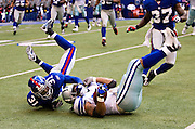 IRVING, TX - JANUARY 13:   Aaron Ross #31 of the New York Giants tackles Marion Barber #24 of the Dallas Cowboys during the NFC Divisional playoff at Texas Stadium on January 13, 2008 in Dallas, Texas.  The Giants defeated the Cowboys 21-17.  (Photo by Wesley Hitt/Getty Images) *** Local Caption *** Aaron Ross;Marion Barber