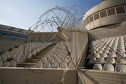 Nicosia, Cyprus - Friday, October 12, 2007: Barbed wire seperates the supporters at the new GPS Stadium ahead of the UEFA Euro 2008 Qualifying match between Wales and Cyprus in Nicosia. (Photo by David Rawcliffe/Propaganda)