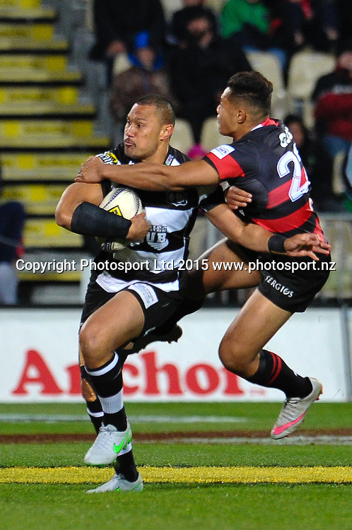Robbie Fruean of Hawkes Bay  fends off Nathaniel Apa of Canterbury during the ITM Cup rugby match, Canterbury v Hawke's Bay, at AMI Stadium, Christchurch, on the 12th September 2015. Copyright Photo: John Davidson / www.photosport.nz