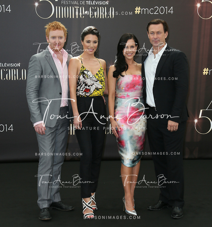 "MONTE-CARLO, MONACO - JUNE 09:  (L to R) Tony Curran, Jaime Murray, Julie Benz and Grant Bowler attend ""Defiance"" photocall at the Grimaldi Forum on June 9, 2014 in Monte-Carlo, Monaco.  (Photo by Tony Barson/FilmMagic)"