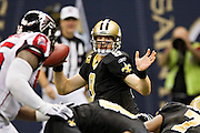NEW ORLEANS, LA - DECEMBER 26:   Drew Brees #9 of the New Orleans Saints tries to avoid the rush during a game against the Atlanta Falcons at Mercedes-Benz Superdome on December 26, 2011 in New Orleans, Louisiana.  The Saints defeated the Falcons 45-16.  (Photo by Wesley Hitt/Getty Images) *** Local Caption *** Drew Brees