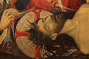 Head of Christ with halo and crown of thorns, from the Lamentation, 1410, by Lluis Borrassa in International Gothic style, on the predella, originally from a different altarpiece (dedicate to St Anthony and disappeared), of the Retaule de l'Esperit Sant (Retablo del Espiritu Santo), or Altarpiece of the Holy Spirit, 1394, by Pere Serra, a Catalan artist, with 22 scenes and 36 figures of saints, in the Colegiata Basilica de Santa Maria, or Collegiate Basilica of Santa Maria, also known as La Seu, built in Gothic style by Berenguer de Montagut, from 1328 until 1486, around an existing 11th century Romanesque church, Manresa, Catalonia, Spain. The altarpiece was commissioned by the Guild of Tanners and contains scenes of the Holy Spirit and Life of Christ. Picture by Manuel Cohen