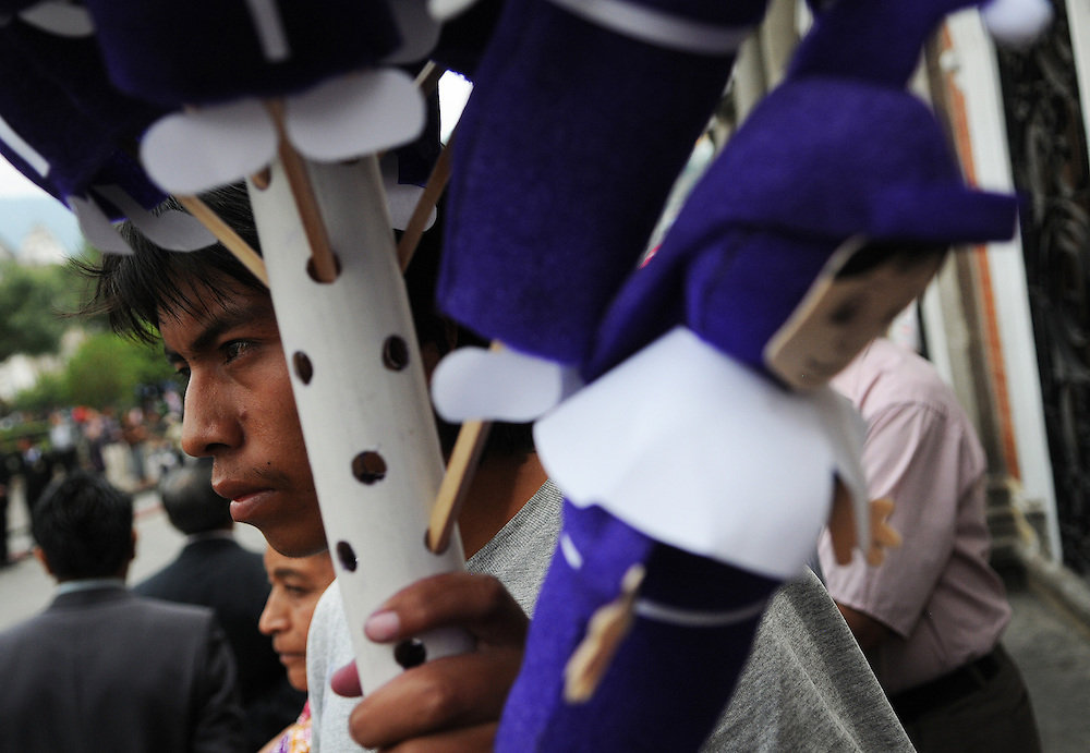 Apr 21, 2011 - Quetzaltenago, Guatemala - A street vender sells Cucuruchos dolls, Cucuruchos are the members of the brotherhoods that accompany and carry the images of the saints during processions. .(Credit Image: © Josh Bachman/ZUMA Press)