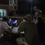 OCCOQUAN, VA - AUG4: Dylan Cain (center), 16, a student at Woodbridge High School, play Pokemon Go in Occoquan, Virginia, with his friends, August 4th, 2016. This sleepy Virginia town has become a hotspot for Pokemon Go. Throughout the night, kids and young adults play the game on the streets, leaving beer bottles and litter behind. A few residents have complained to city hall and now the city is hiring extra police officers to handle the new masses. (Photo by Evelyn Hockstein/For The Washington Post)