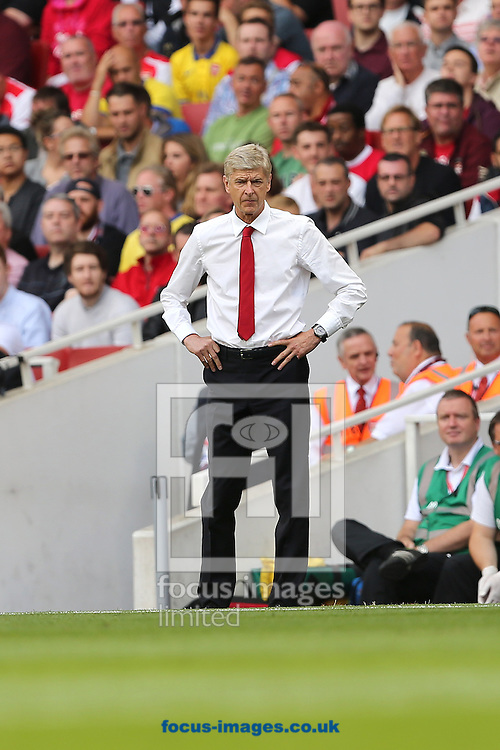 Manager of Arsenal, Arsene Wenger looking frustratied during the Barclays Premier League match at the Emirates Stadium, London<br /> Picture by Richard Calver/Focus Images Ltd +447792 981244<br /> 16/08/2014
