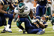 ST. LOUIS, MO - SEPTEMBER 11:   Eugene Sims #92 of the St. Louis Rams tackles Dion Lewis #28 of the Philadelphia Eagles at the Edward Jones Dome on September 11, 2011 in St. Louis, Missouri.  The Eagles defeated the Rams 31 to 13.  (Photo by Wesley Hitt/Getty Images) *** Local Caption *** Eugene Sims; Dion Lewis