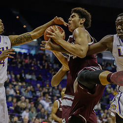 Feb 4, 2017; Baton Rouge, LA, USA; Texas A&M Aggies center Tyler Davis (34) rebounds over LSU Tigers forward Duop Reath (1) and forward Wayde Sims (44) during the first half at the Pete Maravich Assembly Center. Mandatory Credit: Derick E. Hingle-USA TODAY Sports