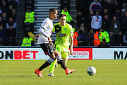 Derby County defender Marcus Olsson clears the ball from Huddersfield Town midfielder Joe Lolley during the Sky Bet Championship match between Derby County and Huddersfield Town at the iPro Stadium, Derby, England on 5 March 2016. Photo by Aaron Lupton.