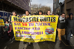 © Licensed to London News Pictures . 28/02/2015 . Newcastle , UK . About 1000 people at a march and demonstration under the name of Newcastle United, opposed to Pegida . Hundreds attend the first Pegida demonstration in the UK , at the Bigg Market in Newcastle . Photo credit : Joel Goodman/LNP