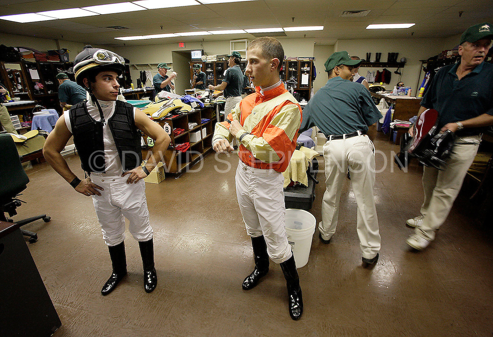 In the jockey's locker room, Mikey James, left, and Matthew Straight talk about the race that James' just finished at Keeneland in Lexington, Ky., on Thursday, October 9, 2008. They are among the first graduates of the North American Racing Academy and are racing at Keeneland this fall. James finished last in his two races for the day, and Straight finished third and last in his two races. Straight has 17 wins since he began racing professionally in July. Photo by David Stephenson | Staff 6711