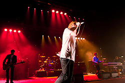 """© Licensed to London News Pictures. 08/06/2012. London, UK. The Charlatans perform live at Hammersmith Apollo, playing their 1997 and fifth studio album """"Telling' Stories"""" in its entirety.  In this picture L to R -  Martin Blunt, Jon Brookes, Tim Burgess, Mark Collins, Tony Rogers.  Photo credit : Richard Isaac/LNP"""
