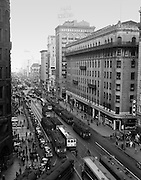 Looking East Down Market Street from Kearny Street at Streetcar Traffic, 5:10 PM | March 20, 1940