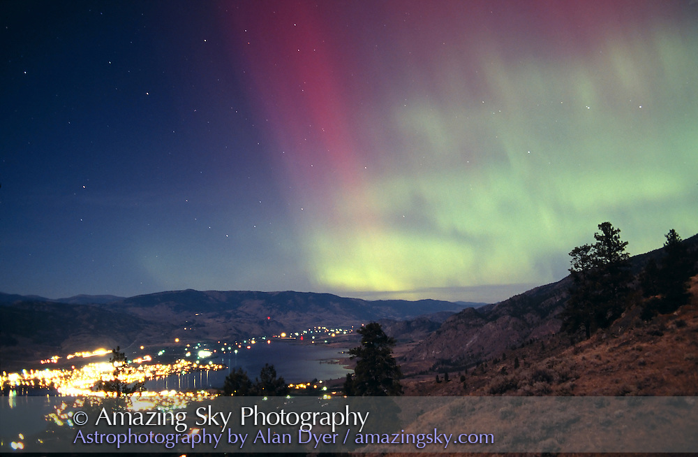 Aurora over Osoyoos, BC, Canada, September 30, 2001..28mm lens at f/2.8, Fuji Provia 400F slide film, exposure about 30s in near full moonlight, providing the landscape illumination...Taken from Jack and Alice Newton's B&B location, overlooking Osoyoos Valley and lake, pn west slope of Anarchist Mountain.
