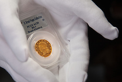 London, March13th 2015. Ahead of the first sale of the D. Brent Pogue rare United States Federal coin  collection sale to be held at Sotheby's  New York. The collection is composed of over 650 gold, silver, and copper coins, and is expected to be the most valuable collection of coins ever sold. PICTURED: An 1822 Five Dollar gold piece, the only example in private hands, which is anticipated to sell for up to £10 million at auction.