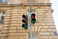 Red traffic light against building; Prague; Czech Republic