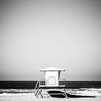 Orange County lifeguard tower black and white picture. Photo was taken in 2012 in Huntington Beach California and is Copyright © 2012 Paul Velgos with All Rights Reserved.