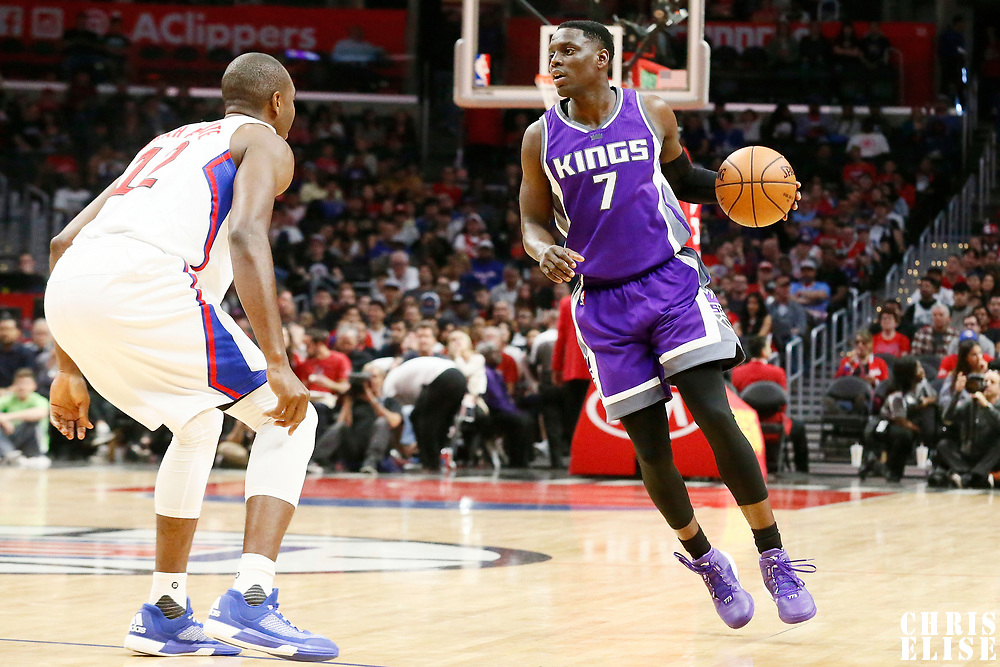 26 March 2016: LA Clippers forward Luc Mbah a Moute (12) defends on Sacramento Kings guard Darren Collison (7) during the Sacramento Kings 98-97 victory over the Los Angeles Clippers, at the Staples Center, Los Angeles, California, USA.