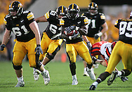 08 SEPTEMBER 2007: Iowa running back Albert Young (21) protects the ball as he runs down field in Iowa's 35-0 win over Syracuse at Kinnick Stadium in Iowa City, Iowa on September 8, 2007.