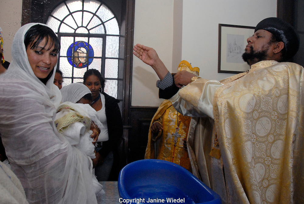 Archbishop baptising baby at the Ethiopian Orthodox Church in Central London.