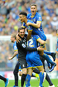 AFC Wimbledon goalkeeper Kelle Roos (29), AFC Wimbledon defender Jon Meades (12), AFC Wimbledon striker Lyle Taylor (33) and AFC Wimbledon defender Ryan Sweeney (20) celebrate winning the play off final against Plymouth Argyle during the Sky Bet League 2 play off final match between AFC Wimbledon and Plymouth Argyle at Wembley Stadium, London, England on 30 May 2016. Photo by Graham Hunt.